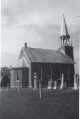 Exterior view of St. John's Evangelical Lutheran Church and cemetery in Augsburg, Ontario