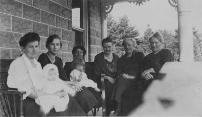 Women and children sitting on a porch