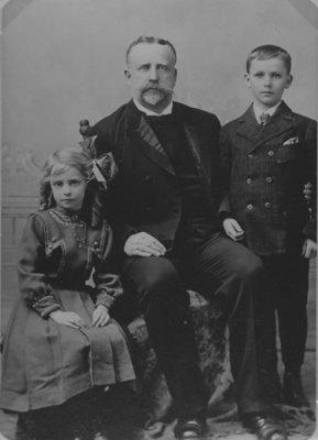 Reverend Guenther Brackebusch and two children