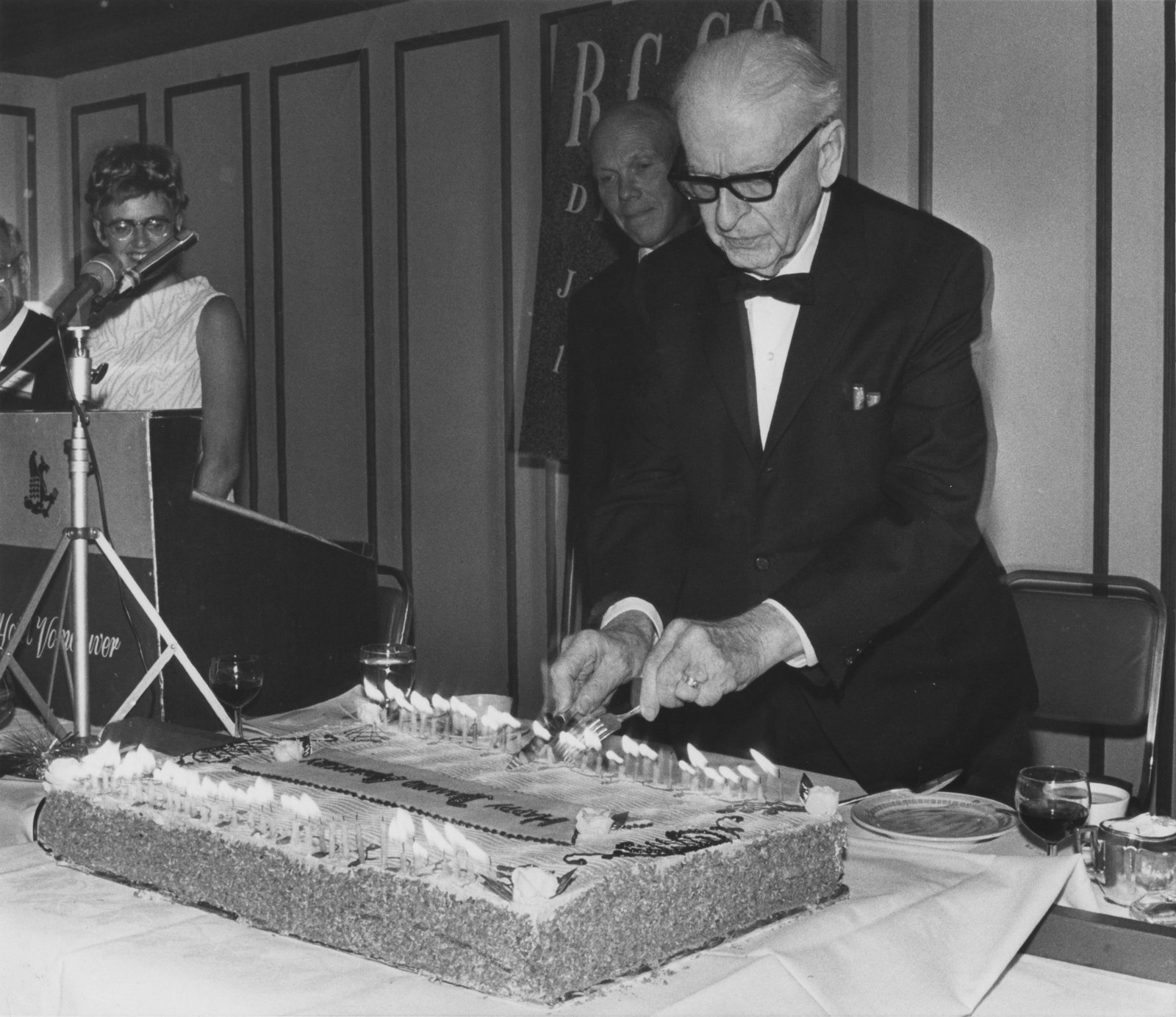 R.G. Geen cutting cake at Royal Canadian College of Organists National Convention, 1969