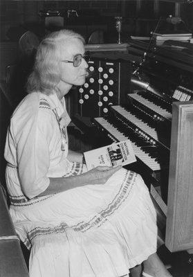 Carol Otto seated at organ