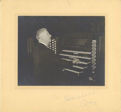 R. G.  Geen playing organ in Moose Jaw, 1958