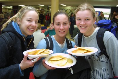 Three female students at Pancake Tuesday Event, Wilfrid Laurier University
