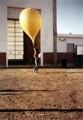 Researcher with weather balloon