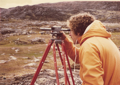 Researcher using survey equipment