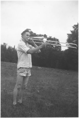 Man playing a trombone, Camp Edgewood, 1947