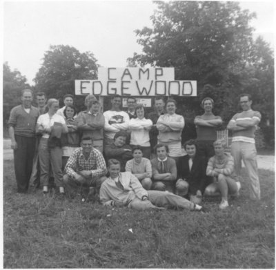 Group of people in front of sign, Camp Edgewood, 1956