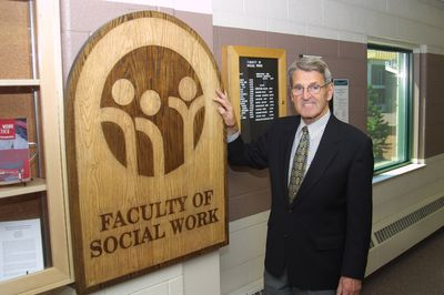 Lyle Hallman and Faculty of Social Work sign, 2002