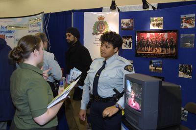 RCMP representative and student at 2002 Career Fair