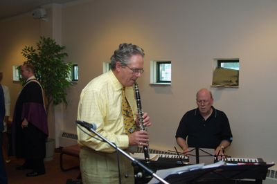 Barry Gough playing clarinet at Spring Convocation reception, 2002