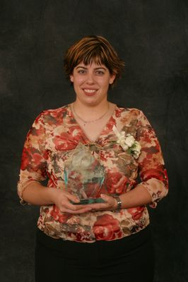 Andrea Harding receiving the student alumna of the year award, 2003
