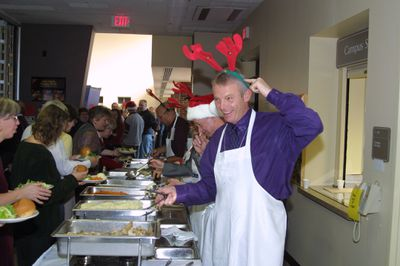 David McMurray serving staff at seasonal lunch, 2001