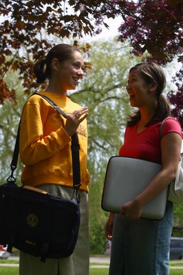 Two students talking on campus, 2003