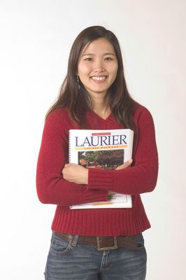 Student holding Laurier course package book, 2004