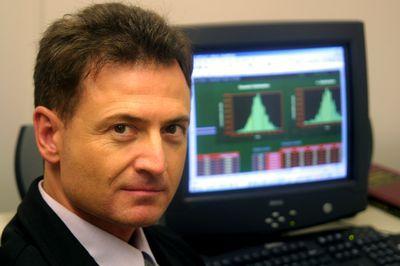 Giuseppe (Joe) Campolieti with computer screen, 2003