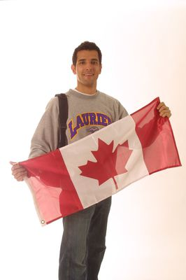 Student holding Canadian flag, 2003