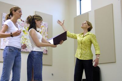 Students practicing singing, 2004