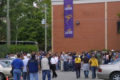 Fans walking into University Stadium for homecoming football game, 2004