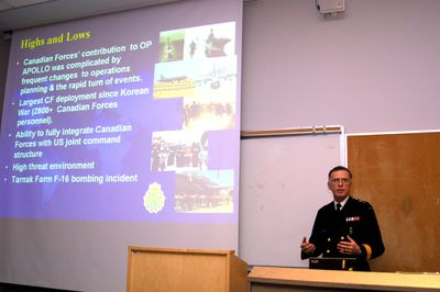 Commodore Jean-Pierre Thiffault giving guest lecture, 2002