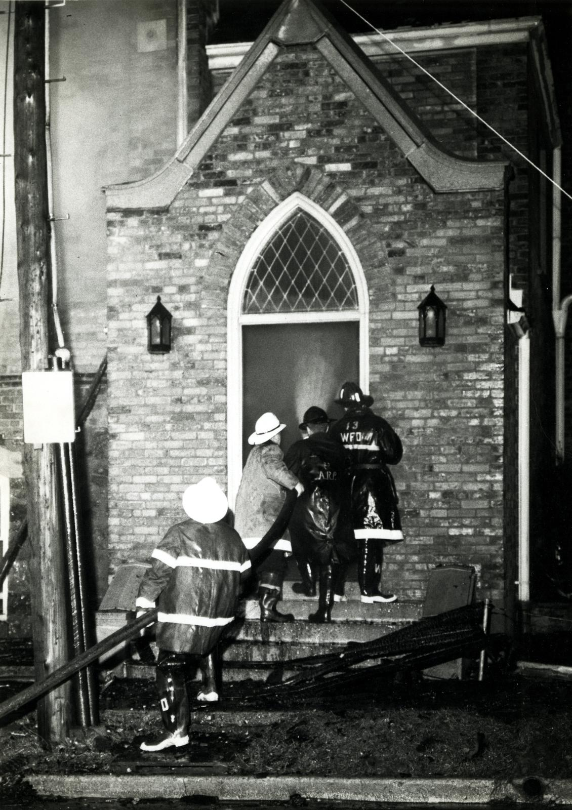 Fire fighters entering St. John's Lutheran Church, Waterloo, Ontario during fire
