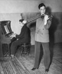 Stanley Bowman playing violin accompanied by Erich Schultz on piano