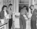 Boarding Club members washing dishes