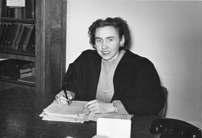 Marion Axford seated at desk