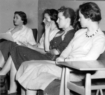 Female Waterloo College students sitting in girls' common room