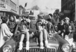 Waterloo College cheerleaders riding on a car in the 1955 Homecoming Parade