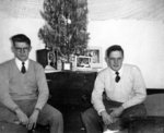 Two Waterloo College students in front of a Christmas tree