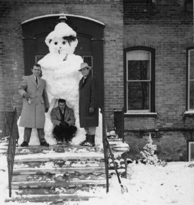 Snowman blocking main entrance to Conrad Hall, Waterloo College