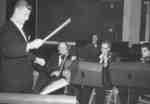 Arthur Freund conducting the 1955 Purple and Gold Revue orchestra