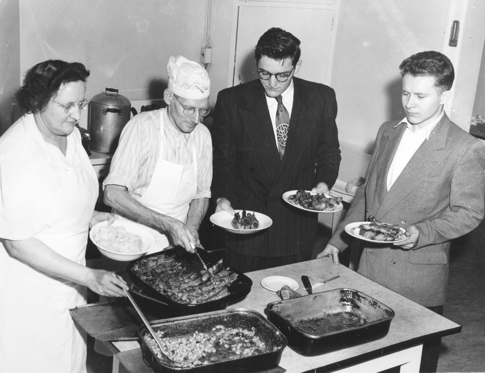 Mammy and Pappy Stalkie serving food to Waterloo College students