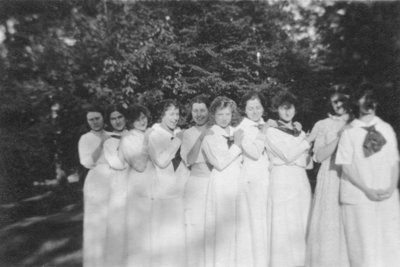 Young women in long dresses