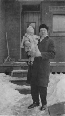 Pastor Carl Sorensen holding a child