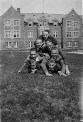Waterloo College students forming a pyramid in front of Willison Hall