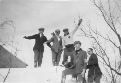 Waterloo College School students on top of a snowbank