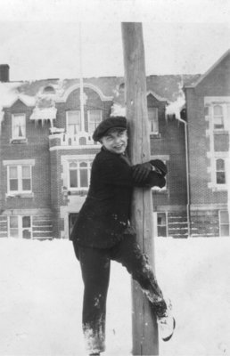 Arthur Mehlenbacher standing in the snow, in front of Willison Hall