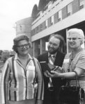 Helen Chapman, Jim Lawson, and Mary Heer holding bookend