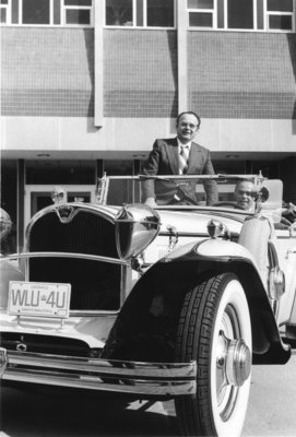 Wilfrid Laurier University President Frank Peters sitting in classic car