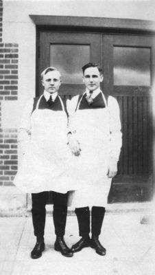 Two Waterloo College School students standing in front of Willison Hall