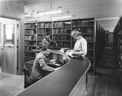 Student and staff in the Library in Willison Hall