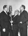 Three men standing with Waterloo Lutheran University mace
