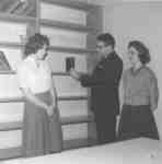 Erich Schultz and two Library staff members