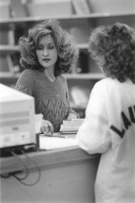 Helen Sagi working at Wilfrid Laurier University Library Circulation Desk