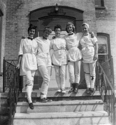 Five female Waterloo College students during initiation week, 1955