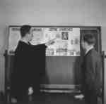 Professor George Durst and student Wilfred Myra in a classroom