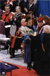 Presentation of flowers to recipient of Outstanding Teacher Award at Spring Convocation 1998, Wilfrid Laurier University