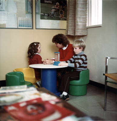 Faculty of Social Work student with two children