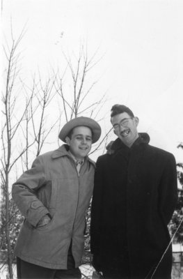 Two men standing outdoors